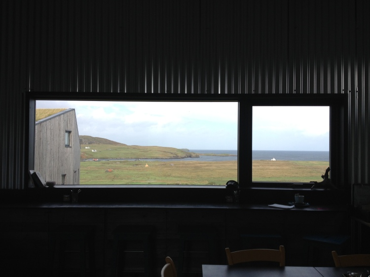 The view over An Aird and Kilmaluag Bay from the Single Track cafe. Indi and Bec's Grand Designs house is the building to the left and the top white speck next to it in the distance is Aird House.
