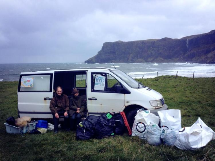 Two of our hardiest beach clean volunteers sheltering from the wind in Vernon's van